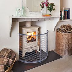 mantel piece and fire guard (wood burner fireplace) Wood Burner Fireplace, Fireplace Guard, Cosy Lounge, Indoor Places, Multi Fuel Stove, Kitchen Stove, Log Burner, Cabin Interiors, White Rooms