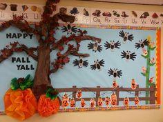 Fall bulletin board with hand print bats & jac-o-lanterns. Finger print Indian corn