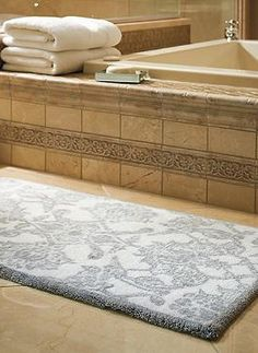 The stylish Giverny Bath Rug offers elegant design and plush comfort underfoot in your master suite while efficiently absorbing and drying excess water.