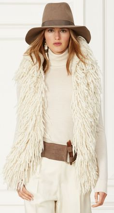 Ralph Lauren Fall 2015 Collection: This cream hand-knit vest has a voluminous silhouette that makes it perfect for layering. Pair the luxe wool-and-cashmere style over a slim-fitting turtleneck and a tailored pant.