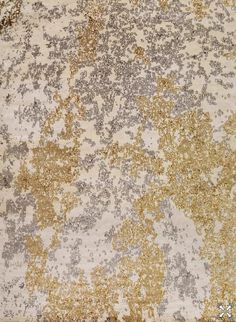 Carini Lang Seychelles rug-Gold and steel-colored fragments create the ethereal mood of Seychelles. The natural white background, woven in a wool silk blend, allows…
