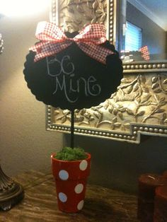 chalk board sign with pot instead of base