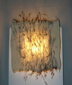 felted wall lamp with grass--clasheen.wordpress.com