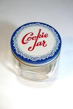 I have this filled with vintage wooden handled cookie cutters. Cookie jar