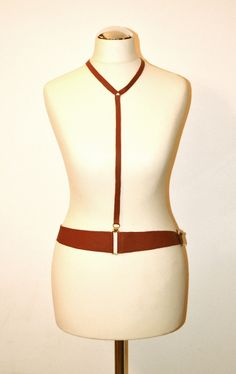 Red leather harness with golden rings and wide belt with buckle https://kivaleatheraccessories.wordpress.com/2015/01/20/cool-leather-harnesses-by-kiva/