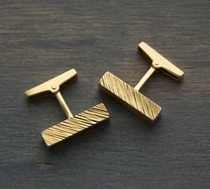 He'll treasure a pair of vintage cufflinks forever.