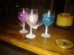 Old wine glasses , glitter, epsom salt, and put a tealite in christmas fun and recycled.