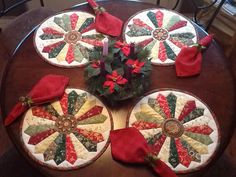 I created round placemats for my small round table using the Dresdan Plate quilt design. The center medallion of each design is different. This will make our small Christmas celebration pretty special.