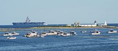 Incredible shot of the USS George HW Bush by Goat Island Light in Cape Porpoise!