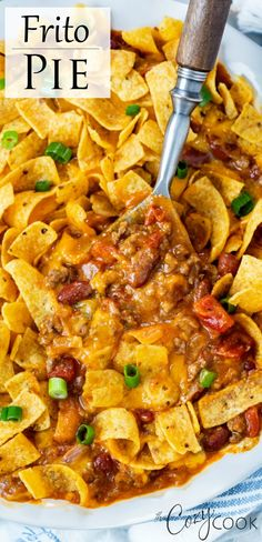 This Frito Pie Recipe has a hearty Beef Chili that's topped with cheese and Fritos and served casserole style. This makes a great make-ahead and freezer meal idea as well! (And it's Crock Pot friendly!) #groundbeefrecipes #budgetmealplanning #freezerfood #recipeswithgroundbeef #crockpotrecipes Easy Pasta Recipes, Supper Recipes, Easy Dinner Recipes, Cooking Recipes, Crockpot Recipes, Dinner Ideas, Asian Recipes, Mexican Food Recipes, Food Recipes
