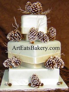 Three tier square custom winter pearl fondant wedding cake with snow covered pine cones and twig design.jpg