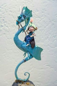 Hand sculpted dragon with a moveable head, made custom for a tiny bjd of a friend