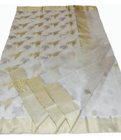 Off-White Chanderi Handloom Silk Saree--------------------Saree makes a woman look elegant and gorgeous compared to any other outfit. You might be surprised to know, the history and origin of saree is as old as Indus valley civilization. There are many varieties and variations of saris found in India, and Chanderi saree is one of them that showcase the beauty of a woman.--------------Sarees from luxurionworld.com