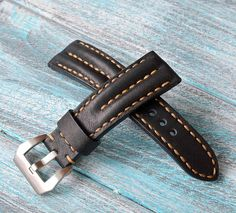 24/20 mm Pudded leather black watch strap