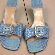 Wet look snake skin printed sandals. Leather slide with silver tone accented buckle. 2.5 inch heels with leather soles. Very good condition Stuart Weitzman Shoes Heels