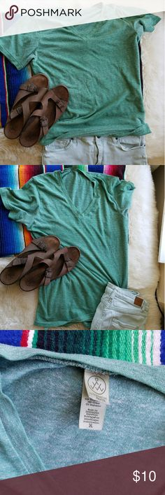 Alternative Earth Jersey V Neck T Shirt Slightly heathered  green stretchy t in Size M. Has small seam coming out at bottom left shown in pic 4 and 5. Just folds under but can also just  be sewn  back in. Alternative Tops Tees - Short Sleeve