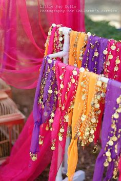 Such a fun idea for an Arabian Nights party: a  belly dance scarf for each guest.