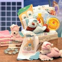 """SKU: 890192 Price: $59.99   This product cannot be shipped outside the USA.  A Sweet Dreams Sleeping Teddy Bear with a pillow rattle delivers the Sweet Dreams Baby New Baby Basket. This fabric lined baby storage hamper carries baby grooming items, a first hand print kit, a sweet baby picture frame, and lots of good wishes for sweet dreams for baby! Send the Sweet Dreams Baby New Baby Basket to new arrivals of your family and friends. """"Fabric Lined Baby Storage Hamper  Sweet Dreams Sleeping…"""