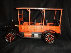 This is a Classic Woodie Wagon It is from 1926 Made out of Tin This is completely hand made and hand painted. Extravagant detail on the interior and exterior of the car. The wheels are movable and fun