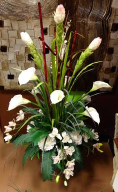White calla lily and orchid arrangement designed by Arcadia Floral and Home Decor.