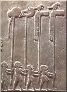 Procession - King celebrates its triumph over enemies. He is followed by four-bearers, from left to right: a sign identified as the royal placenta, a sign  of  god Wepwawet as jackal and two signs  of Horus falcon. The placenta is an old sign which refers to the lunar symbolism and the notion of gestation and regeneration. From The Narmer Palette, also known as the Great Hierakonpolis Palette or the Palette of Narmer.