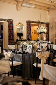 Retro Hollywood Glam - will the hall provide alternate color table cloths? Black linens give that formal/evening feel, and keep the white decor from being too overwhelming