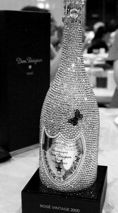 Swarovski-embellished bottle of vintage Dom Perignon Champagne - how fabulous!  http://www.davidshuttle.com/products/the_summer_sale/1223/
