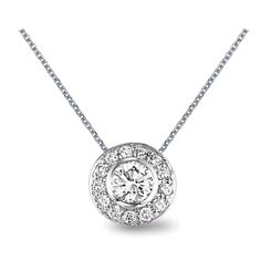 This stunning diamond pendant is classically modern with a center diamond surrounded by a sleek circle of smaller round diamonds. Bridgeport Gold & Silver we have made this pendant in round as well as square with princess diamonds!