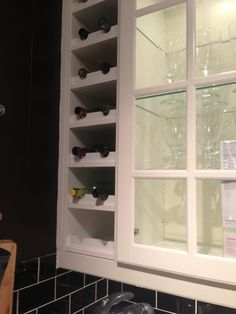 Wine rack built-in next to kitchen cabinets c/o IKEA