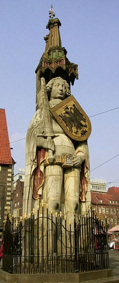 Bremen, Germany  Statue of Roland, erected 1404. It stands in the market square (Rathausplatz).  Protector of city: his legendary sword (known in chivalric legend as Durendal) is unsheathed, shield emblazoned with two-headed Imperial eagle.