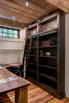 A tiny nook is turned into a charming home office with a built-in corner desk and tall bookshelves. A sliding ladder adds old-fashioned style and practicality!
