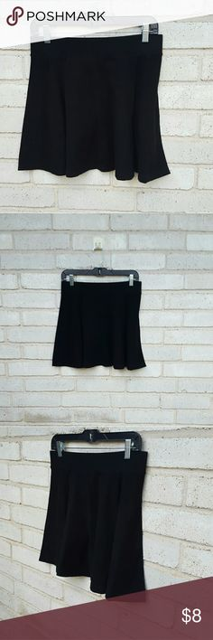 """Forever21 Minimalist Chic Black Skater Skirt Large Forever21 soft knit fabric black skater style skirt. Excellent condition. Tagged a size Large and runs true to size.  Measurements : Length 17"""" 15""""across front waist laying flat unstretched  #ravenkittystyle #skater #skirt #black #knit #casual #large #minimalist #staple #musthave #spring #summer #layer Forever 21 Skirts Circle & Skater"""
