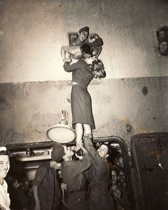 Marlene Dietrich is hoisted up to kiss her man as returns home from World War II, 1945. Many powerful images of this sort became popular during this era. The realities of war effected everyone, even the rich – even the famous.