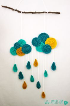 Crochet Raincloud on a wooden branche, used as a mobile. Great colours!  #gehaakte #regenbui #crochet #rainclouds