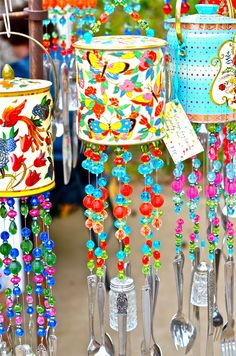 Garden art wind chimes made frm cans, beads, cutlery, and salt and pepper shakers