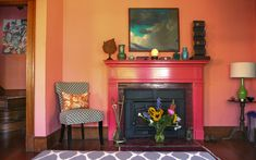 Alix & Nick's Cheerful Dream Home: PEACH walls against dark orange floorboards. Coordinates perfectly with all my favorite shades: pink, turquoise, yellow, orange, red and green. My Living Room, Living Spaces, Painted Mantle, Painted Fireplaces, Peach Walls, Brick Paneling, Edwardian House, Funky Home Decor, Boho Decor