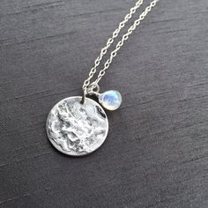 "A handcrafted organic fine silver(.999%) Crater Moon pendant paired with a dainty genuine moonstone charm.Hangs on a 18"" sterling silver chain and perfect for the moon lovers!($52) #moonjewelry #silverjewelry #modernjewelry"