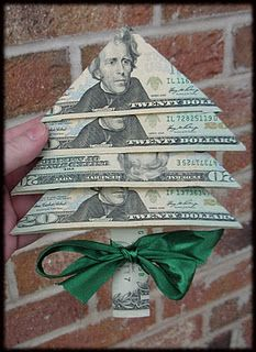 Money Tree -- Fold money into little Christmas trees; would make a cute stocking stuffer gift for kids (make it under $5 by using $1's)