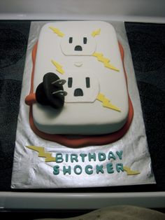 """The perfect cake honoring the Great Electrician!  """"Birthday Shocker!""""  Fondant extension cord.  His favorite peanut butter cake with chocolate peanut butter ganache."""