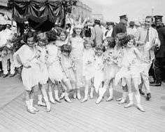 This photograph shows Miss Margaret Gorman, the 1921 Miss America, on the boardwalk in Atlanric City, NJ. Surrounding her are her official escorts. Great Photos, Old Photos, Miss America Winners, Vintage Vignettes, Boardwalk Empire, Atlantic City, Strike A Pose, City Photo, Old Things