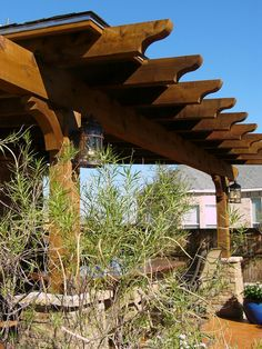 Architecture in the landscape should never be forgotten. This cedar arbor provides shade while establishing the garden's style.
