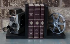 Revere  Eye-Matic - Vintage Camera Bookends - DVD Holder - Movie Theater Decor by LightAndTimeArt on Etsy https://www.etsy.com/listing/472178946/revere-eye-matic-vintage-camera-bookends