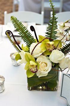 Fern-Fiddlehead-Orchid-Rose-Centerpiece - we'll be creating these for our Bride in October but in shades of deep rich orange. :)
