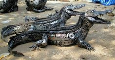 Alligators made from scrap metal, and car pieces