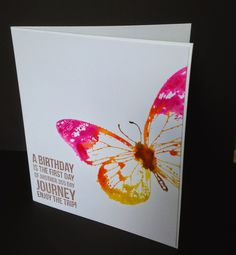 IndigoBlu's lovely Big Butterfly stamp, inked up with distress inks and then spritzed with water before stamping