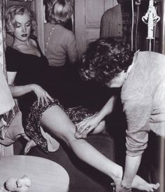 """talesfromweirdland: """"A little polish goes a long way. Marilyn Monroe receives some body makeup during filming of Love Nest (1951). """""""