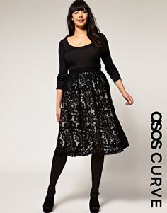 black boat neck long sleeve shirt. black lace midi skirt. black belt. black stockings. black heels. Asos Curve.