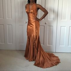 % silk evening gown 60 inches from back to train. 47 inches from under just to floor. 2 splits at both knees. Beautiful movement! Copper colored Dresses Maxi