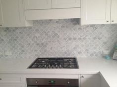 Fish Scale Tile Backsplash - Design photos, ideas and inspiration. Amazing gallery of interior design and decorating ideas of Fish Scale Tile Backsplash in dining rooms, bathrooms, kitchens by elite interior designers. Transitional Home Decor, Transitional Kitchen, Kitchen Colors, Kitchen Backsplash, Neutral Kitchen, Backsplash Ideas, Stainless Steel Gas Stove, Ivory Cabinets, New Kitchen