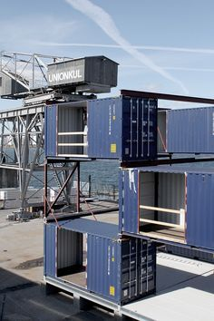 built from old shipping containers, arcgency's STACK II is designed to accommodate companies on a vacant site on the northern harbor of copenhagen.